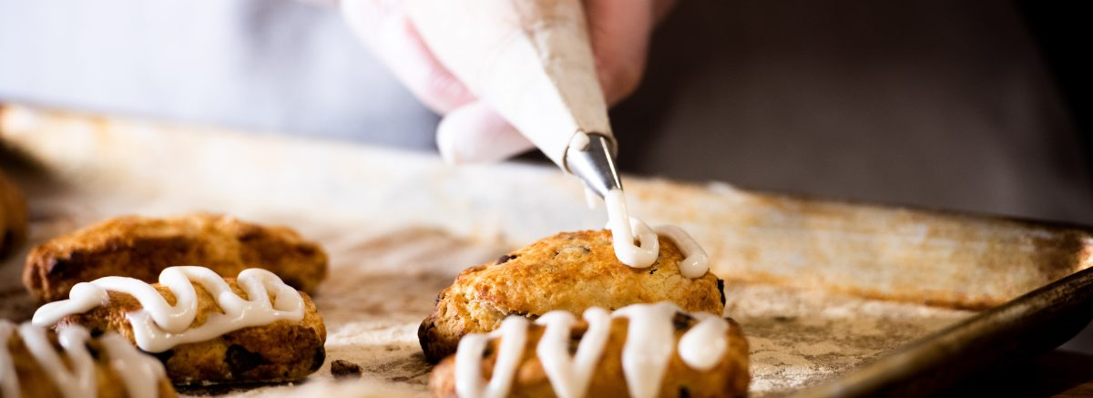Icing going on a scone